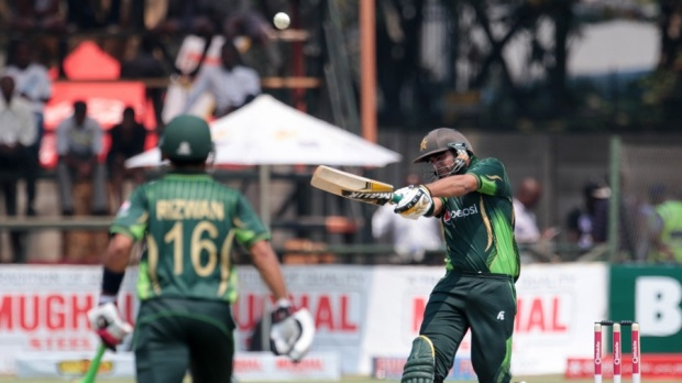 Pakistan batsman Imad Wasim (L) plays a shot as teammate Mohammad Rizwan prepares to run during the first in a series of three One Day International (ODI) cricket matches between Pakistan and hosts Zimbabwe at the Harare Sports Club, in Harare on October 1, 2015. AFP PHOTO / JEKESAI NJIKIZANA (Photo credit should read JEKESAI NJIKIZANA/AFP/Getty Images)